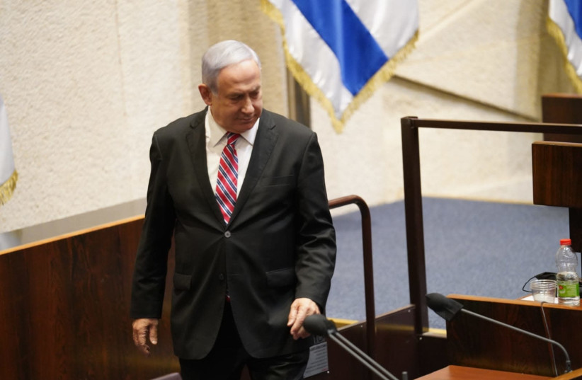 Prime Minister Benjamin Netanyahu at the Knesset, as it disperses, sending Israel into elections in March, December 22, 2020.  (photo credit: KNESSET SPOKESPERSON/DANI SHEM TOV)