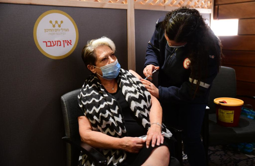 Elderly residents receive coronavirus vaccine at Mediterranean Towers assisted living, Dec. 22, 2020 (photo credit: AVSHALOM SASSONI/ MAARIV)