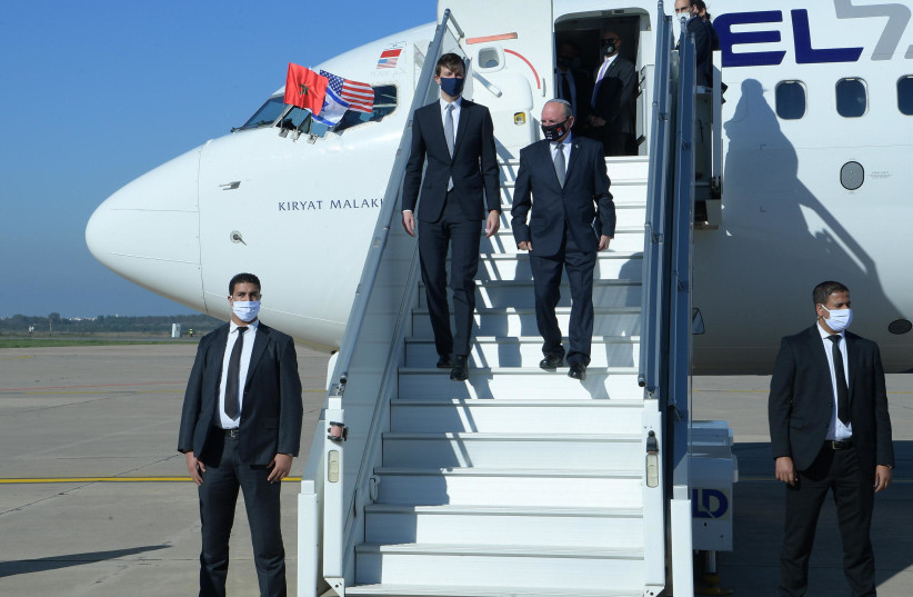 White House senior adviser Jared Kushner (L) and Israel's National Security Adviser Meir Ben-Shabbat are seen in Rabat disembarking from the first direct El Al flight from Israel to Morocco on December 22, 2020. (photo credit: AMOS BEN-GERSHOM/GPO)