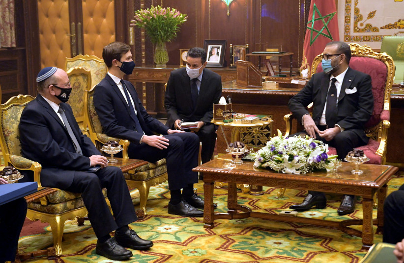 Meir Ben Shabbat and Jared Kushner meet with King Mohammed VI of Morocco (photo credit: AMOS BEN GERSHOM, GPO)