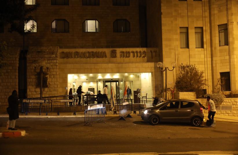 Individuals get set up at a corona-designated hotel in Jerusalem, December 21, 2020.  (photo credit: MARC ISRAEL SELLEM)