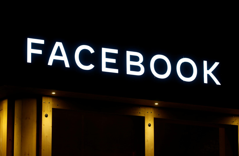 The logo of Facebook is seen in Davos, Switzerland January 20, 2020. (photo credit: ARND WIEGMANN / REUTERS)