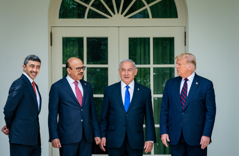 "From left to right: UAE Foreign Minister Abdullah bin Zayed Al Nahyan, Bahrain Foreign Minister Abdullatif bin Rashid Al Zayani, Israeli Prime Minister Benjamin Netanyahu and President Donald Trump at the signing ceremony for the agreements on ""normalization of relations"" reached between Israel, the (photo credit: THE WHITE HOUSE)"
