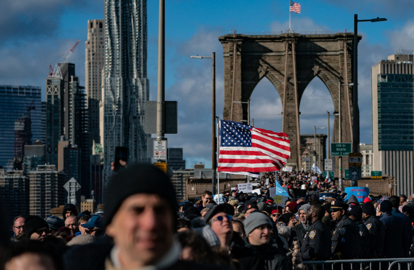 Participants in a Jewish solidarity march across New York City's Brooklyn Bridge, Jan. 5, 2020. The march in the city was held in response to a recent rise in anti-Semitic crimes in the New York metropolitan area. (Jeenah Moon/Getty Images) (photo credit: JEENAH MOON)