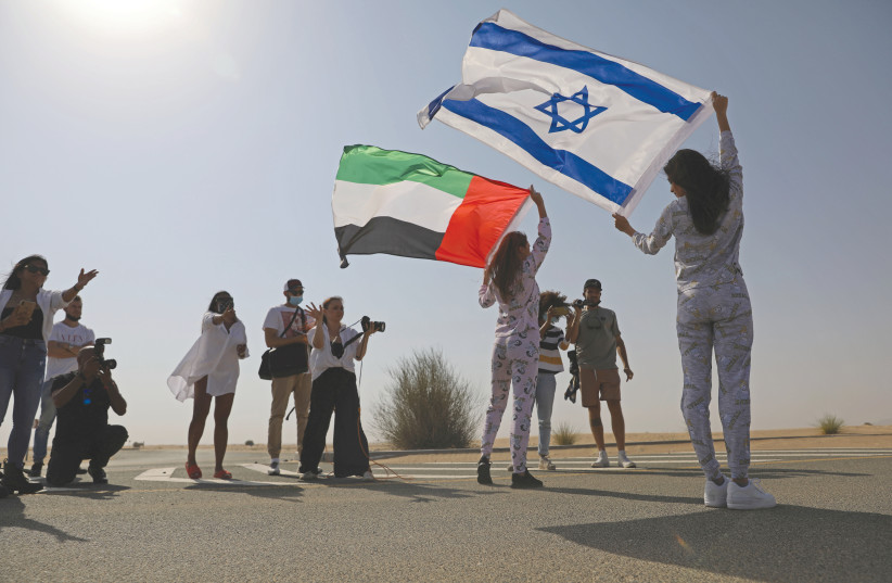 AN ISRAELI and a UAE model pose in Dubai in September. (photo credit: CHRISTOPHER PIKE/REUTERS)