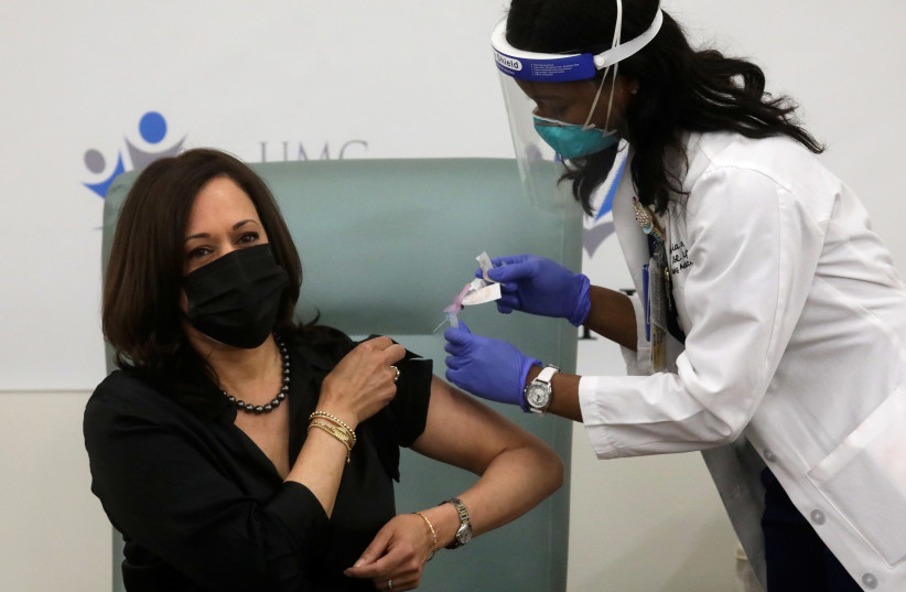 US Vice President-elect Kamala Harris receives a dose of the Moderna COVID-19 vaccine in Washington (photo credit: REUTERS)