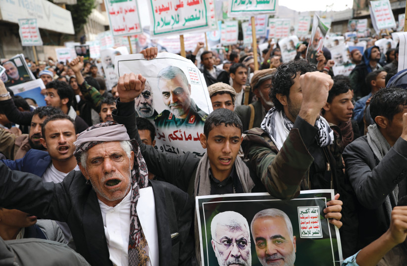HOUTHI SUPPORTERS rally to denounce the US killing of Iranian military commander Qasem Soleimani and Iraqi militia commander Abu Mahdi alMuhandis, in Sana'a, Yemen, on January 6. The placards read, 'God is the greatest, death to America, death to Israel, Curse on the Jews, victory to Islam.' (photo credit: KHALED ABDULLAH/ REUTERS)
