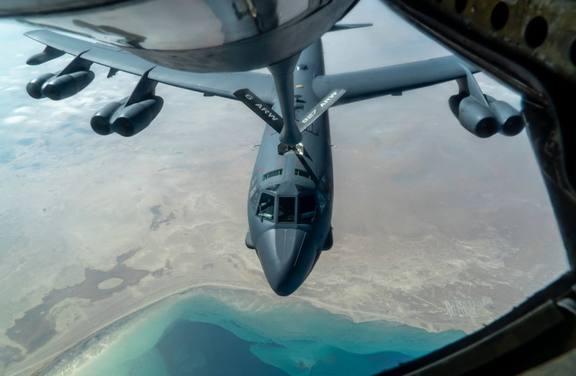 A U.S. Air Force B-52 from Minot Air Force Base is aerial refueled by a KC-135 Stratotanker over the U.S. Central Command area of responsibility Dec. 30, 2020. The B-52 Stratofortress is a long-range, heavy bomber that is capable of flying at high subsonic speeds at altitudes of up to 50,000 feet an (photo credit: U.S. AIR FORCE PHOTO BY SENIOR AIRMAN ROSLYN WARD)