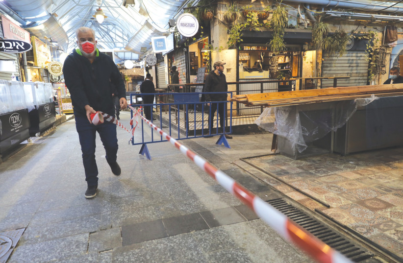 BLOCKING OFF the alleys in the Mahaneh Yehuda market last week.  (photo credit: MARC ISRAEL SELLEM/THE JERUSALEM POST)