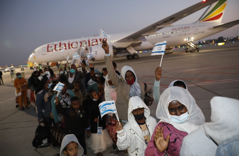 New Ethiopian immigrants are seen at Ben-Gurion Airport on one of the first aliyah flights of the new year, on January 1, 2021. (photo credit: OLIVIA FITOUSI/JAFI)
