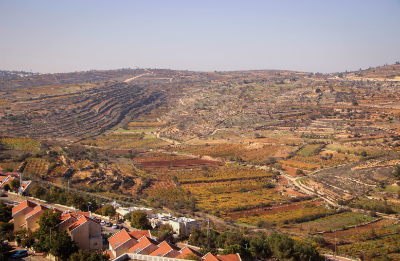 View of the Jewish settlement of Efrat and the surrounding fields, in Gush Etzion, West Bank, on December 1, 2020.  (photo credit: GERSHON ELINSON/FLASH90)