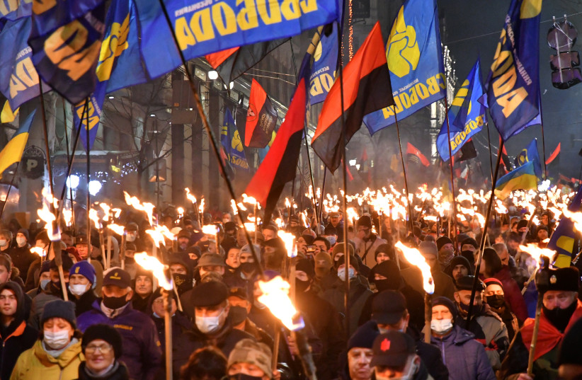 Participants of an annual event in honor of Stepan Bandera march through Kyiv, Ukraine on Jan. 1, 2021. (photo credit: GENYA SAVILOU/AFP VIA GETTY IMAGES)