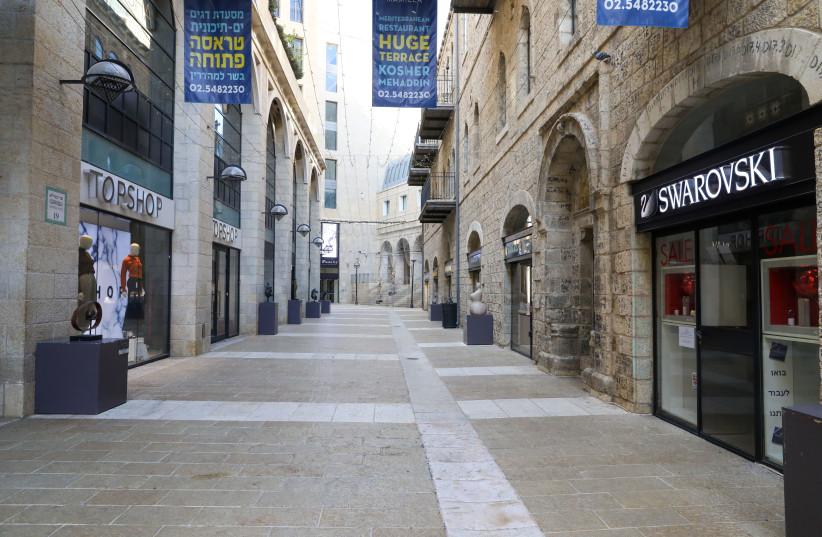 Jerusalem's Mamilla mall is seen nearly empty amid Israel's third coronavirus lockdown, on January 4, 2021. (photo credit: MARC ISRAEL SELLEM/THE JERUSALEM POST)
