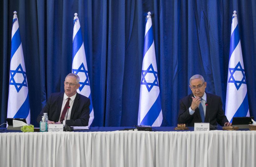 Israeli prime minister Benjamin Netanyahu and Alternate Prime Minister and Minister of Defense Benny Gantz at the weekly cabinet meeting, at the Ministry of Foreign Affairs in Jerusalem on June 28, 2020.  (photo credit: OLIVIER FITOUSSI/FLASH90)