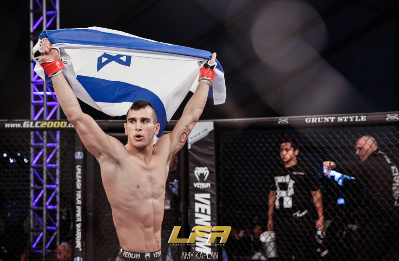 Natan Levy proudly shows an Israeli flag before his matches.  (photo credit: AMY KAPLAN)