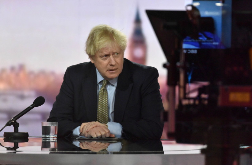 Britain's Prime Minister Boris Johnson appears on BBC TV's The Andrew Marr Show in London, UK, January 3, 2021 (photo credit: JEFF OVERS/BBC/HANDOUT VIA REUTERS)