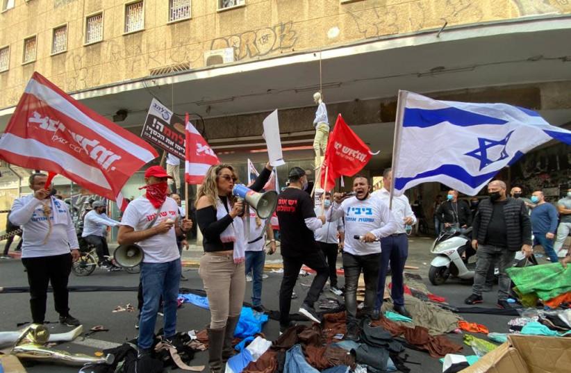 Shop and small business owners protested coronavirus lockdown regulations in Tel Aviv. (photo credit: AVSHALOM SASSONI/ MAARIV)