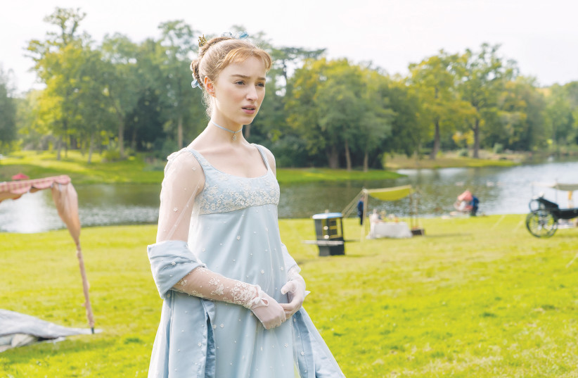PHOEBE DYNEVOR stars as Daphne Bridgerton in 'Bridgerton,' a TV show primarily dedicated to the premise that the British aristocracy schemed and lied in order to marry for money.  (photo credit: LIAM DANIEL/NETFLIX)
