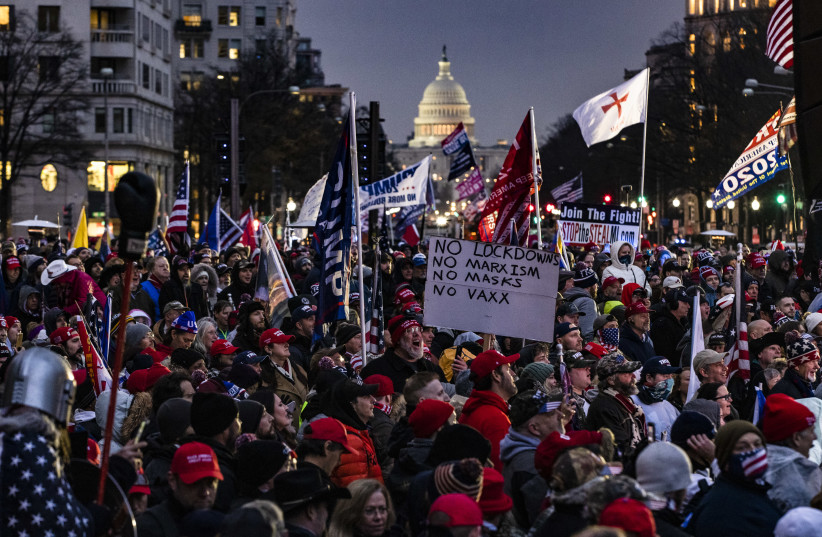 Supporters of President Donald Trump gather for a rally at Freedom Plaza in Washington, DC on January 5, 2021. A string of extremists are expected at the rally. (Samuel Corum/Getty Images) (photo credit: SAMUEL CORUM/GETTY IMAGES)