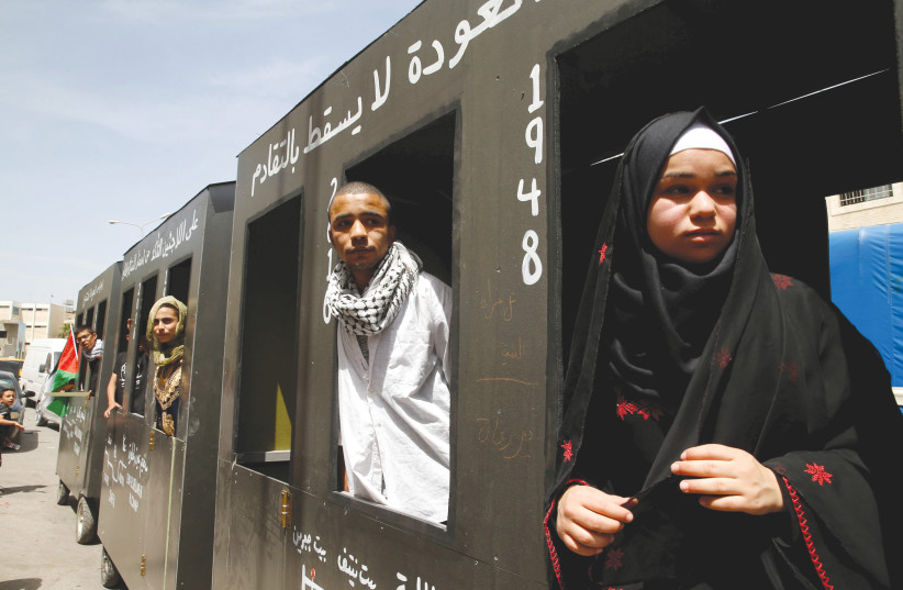 DEMONSTRATORS IN Bethlehem ride a mock train to symbolize the return to homes that Palestinians lost during the 1948 War of Independence, in May 2016. (photo credit: AMMAR AWAD/REUTERS)