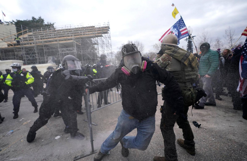 Protesters and police clash at the foot of the US Capitol, January 6, 2021.  (photo credit: Courtesy)