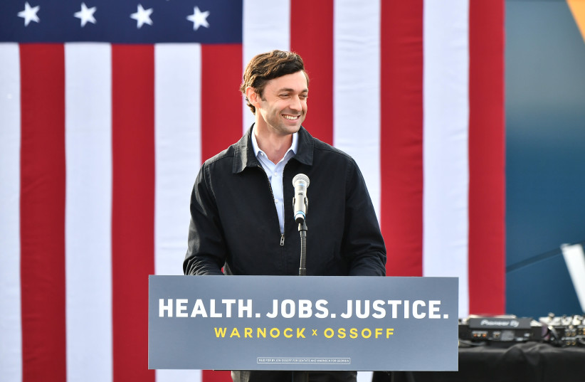 Jon Ossoff speaks in Stonecrest, Ga., Dec. 28, 2020. (Paras Griffin/Getty Images) (photo credit: PARAS GRIFFIN/GETTY IMAGES/JTA)