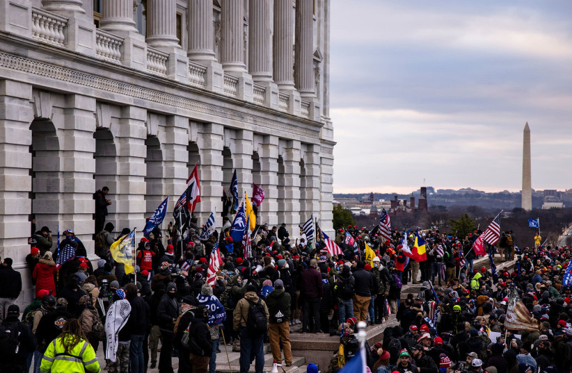 A pro-Trump mob storms the U.S. Capitol following a rally with President Donald Trump on January 6, 2021 in Washington, DC. Trump supporters gathered in the nation's capital today to protest the ratification of President-elect Joe Biden's Electoral College victory over President Trump in the 2020 el (photo credit: SAMUEL CORUM/GETTY IMAGES)