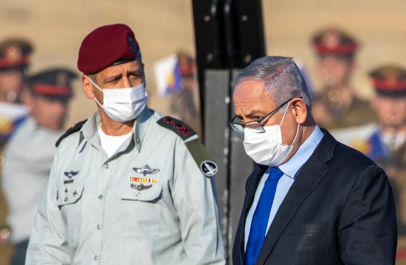 Attending an IAF pilot graduation with Prime Minister Benjamin Netanyahu (photo credit: ARIEL SCHALIT/POOL))
