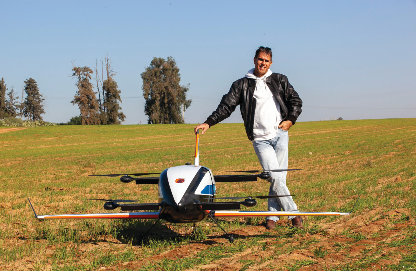 EYAL REGEV with one of Gadfin's air cargo drones (photo credit: Courtesy)