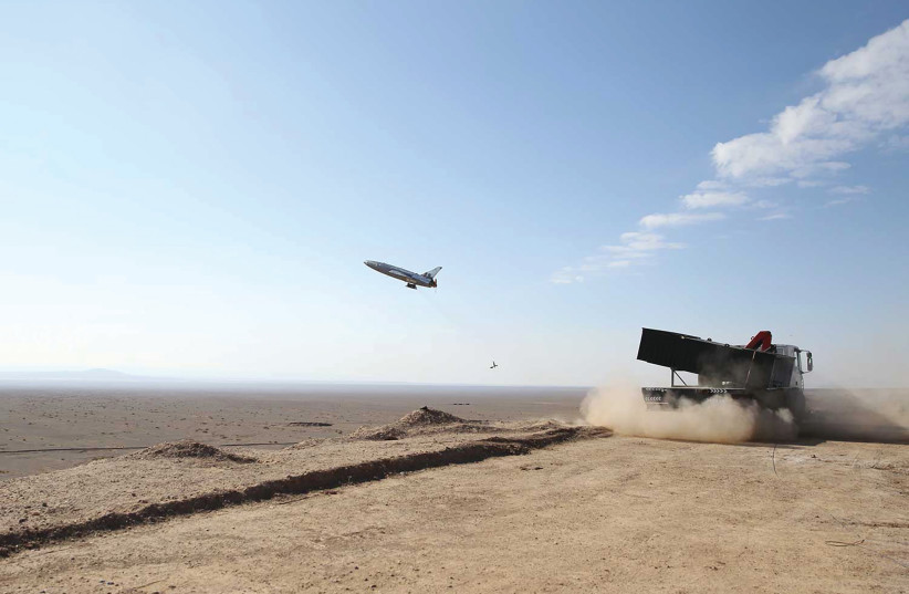 A DRONE IS launched during an Iranian army large-scale drone combat exercise on Wednesday. (photo credit: IRANIAN ARMY/WANA/REUTERS)