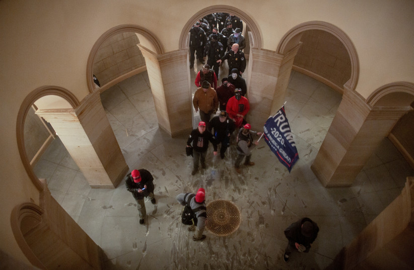 Pro-Trump protesters storm the U.S. Capitol during a rally to contest the certification of the 2020 US presidential election results by the US Congress, at the US Capitol Building in Washington, DC, US January 6, 2021.  (photo credit: REUTERS/AHMED GABER)
