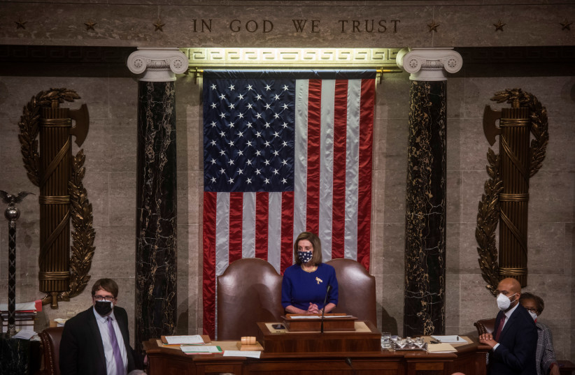 House Speaker Nancy Pelosi (D-CA) speaks as Congress reconvenes in the House chamber to debate Arizona's certification of electoral college votes at the US Capitol in Washington, US, January 6, 2021 (photo credit: AMANDA VOISARD/POOL VIA REUTERS)
