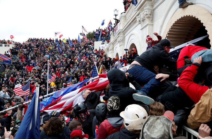 Pro-Trump protesters storm into the US Capitol during clashes with police, during a rally to contest the certification of the 2020 US presidential election results by the US Congress, in Washington, US, January 6, 2021 (photo credit: REUTERS/SHANNON STAPLETON)
