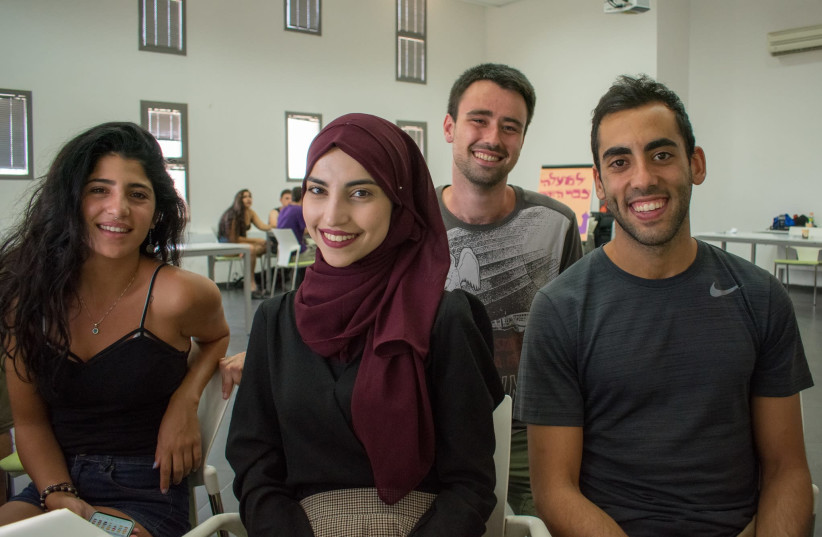 Young Israeli and Palestinian entrepreneurs and tech enthusiasts participate in a recent Tech2Peace program. (photo credit: Courtesy)