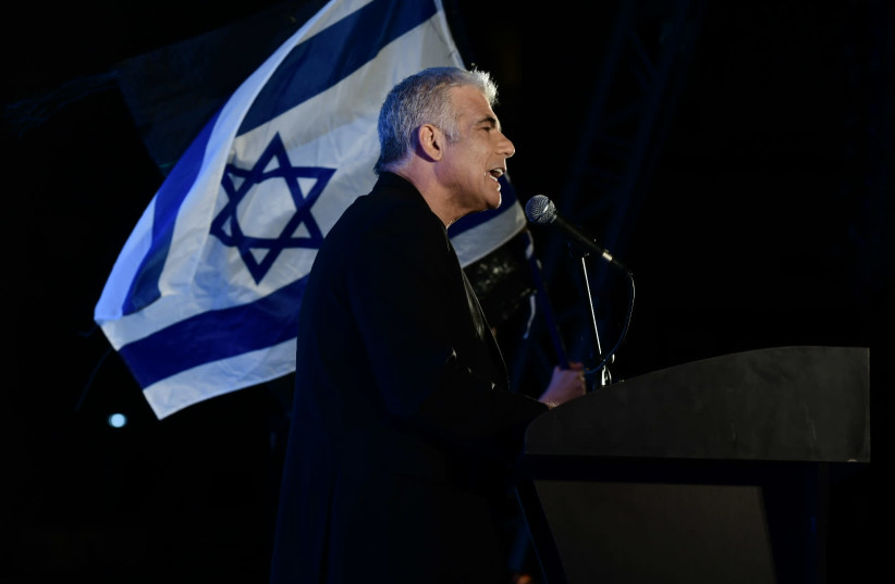 MK Yair Lapid speaks during a protest against Prime Minister Benjamin Netanyahu calling on him to quit, at Rabin Square in Tel Aviv on April 19, 2020. (photo credit: TOMER NEUBERG/FLASH90)