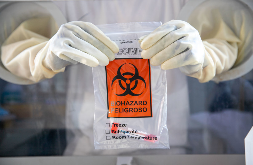 Israelis perform tests for the coronavirus at a Maccabi Test Center, in Ramle. January 7, 2021 (photo credit: YOSSI ALONI/FLASH90)
