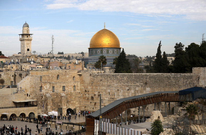 A general view of Jerusalem's Old City shows the Western Wall, Judaism's holiest site, in the foreground as the Dome of the Rock, located on the compound known to Muslims as Noble Sanctuary and to Jews as Temple Mount, is seen in the background. (photo credit: REUTERS/AMMAR AWAD)