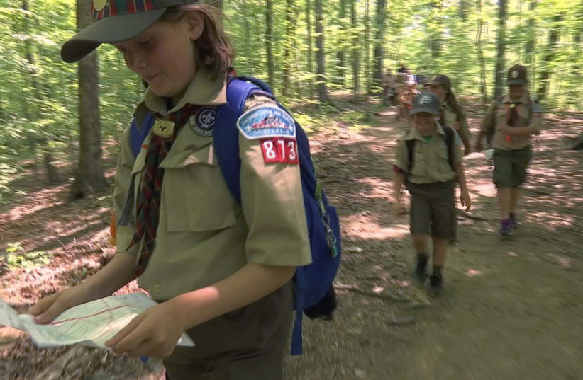 "Girls from Cub Scout Den 13, a suburban Virginia Cub Scout unit made up of girls who are on their way to next year becoming the first female Scouts in the Boy Scouts of America as part of the the newly named ""Scouts BSA"" program, participate in a hike in this still image from video shot in McLean, V (photo credit: REUTERS)"