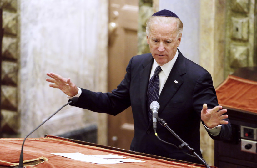 Then-US vice president Joe Biden speaks at the funeral of US Sen. Frank Lautenberg in New York's Park Avenue Synagogue in 2013. (photo credit: RICHARD DREW/POOL/REUTERS)