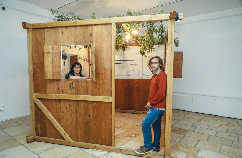 LEA MAUAS and Diego Rotman stand in one of the sukkot that are part of the 'Permanent Residency' exhibition. (photo credit: MARC ISRAEL SELLEM/THE JERUSALEM POST)