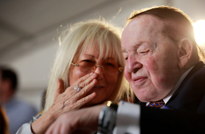 Miriam and Sheldon Adelson attend a cornerstone-laying ceremony for the Health and Medical Sciences School building, named after them, at Ariel University (photo credit: AMIR COHEN/REUTERS)