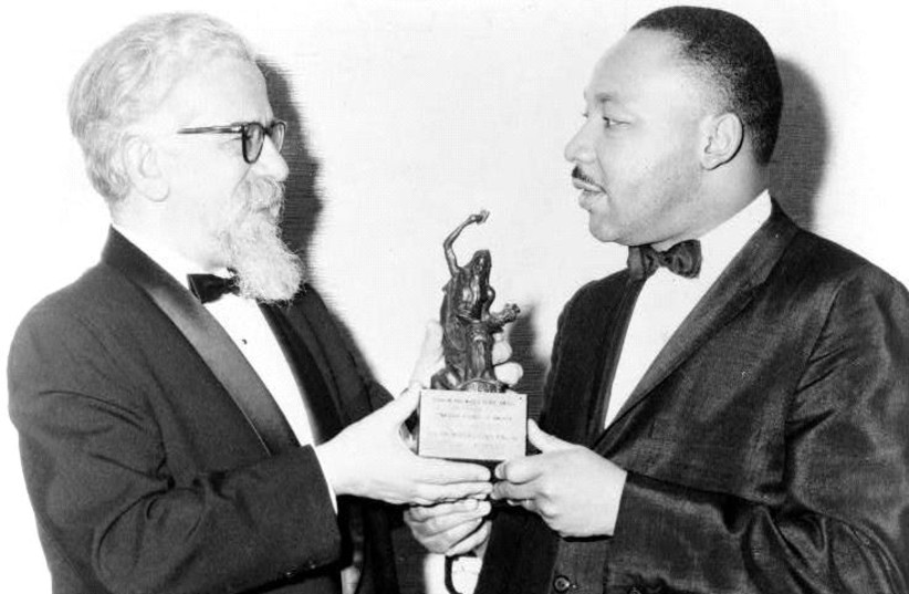 Prof. Abraham Joshua Heschel presents the Judaism and World Peace Award to Martin Luther King Jr. on December 7, 1965. (photo credit: WIKIPEDIA)