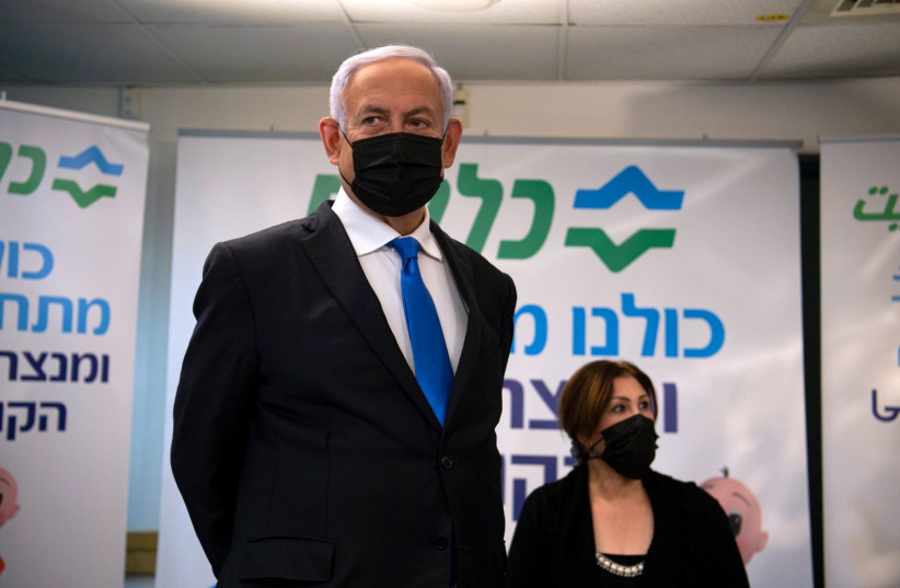 Prime Minister Benjamin Netanyahu is seen at a Clalit clinic in Nazereth. (photo credit: GIL ELIYAHU/HAARETZ/POOL)