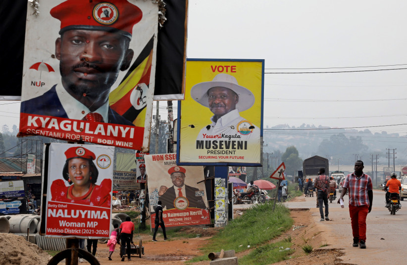 Elections billboards for Uganda's President Yoweri Museveni, and opposition leader and presidential candidate Robert Kyagulanyi, also known as Bobi Wine, are seen on a street in Kampala (photo credit: BAZ RATNER/REUTERS)