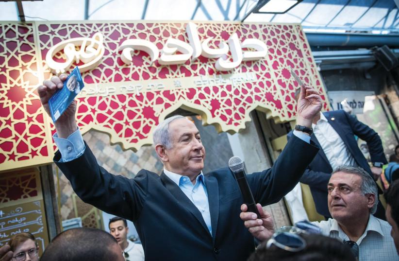 PRIME MINISTER Benjamin Netanyahu makes a pre-election visit to Jerusalem's Mahaneh Yehuda market in February 2020 (photo credit: YONATAN SINDEL/FLASH 90)