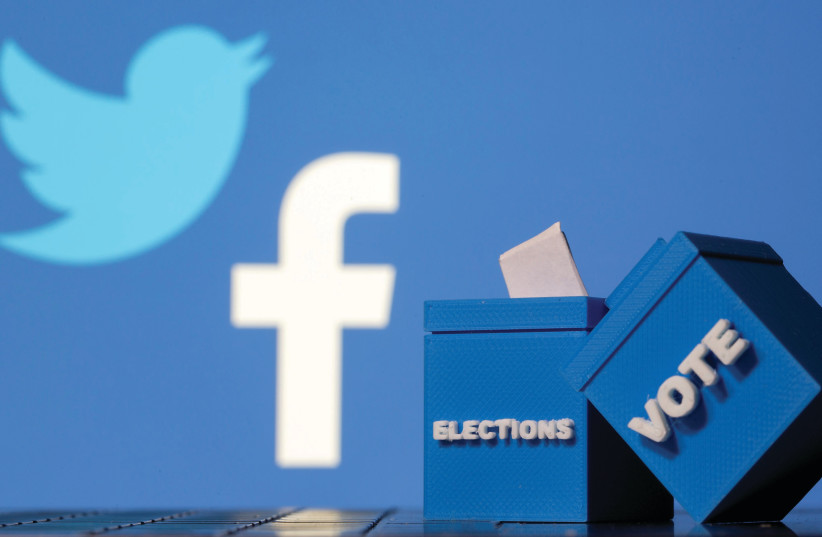3D-PRINTED BALLOT BOXES are seen in front of Facebook and Twitter logos. (photo credit: DADO RUVIC/REUTERS)