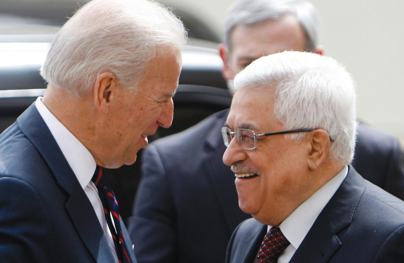 PALESTINIAN AUTHORITY President Mahmoud Abbas (right) greets then-US vice president Joe Biden in 2010. Abbas seized upon the election of Biden as an opportunity to position himself as a positive actor. (photo credit: MOHAMAD TOROKMAN/REUTERS)