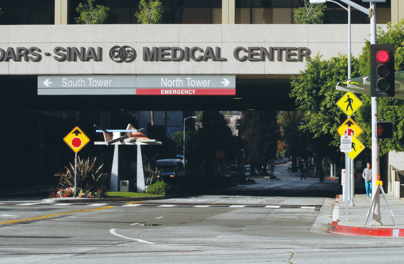 THE ENTRANCE TO Cedars-Sinai Medical Center in Los Angeles, which has been inundated with COVID-19 patients. (photo credit: BENOIT TESSIER/REUTERS)