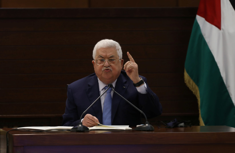Palestinian President Mahmoud Abbas attends a virtual meeting with Palestinian factions over Israel and the United Arab Emirates' deal to normalize ties, in Ramallah in the West Bank September 3, 2020.  (photo credit: ALAA BADARNEH/POOL VIA REUTERS)