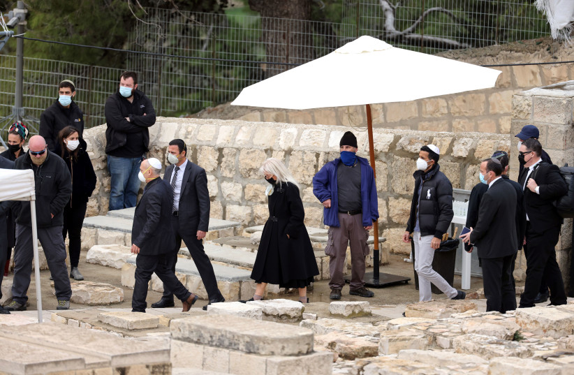Miriam Adelson, wife of Sheldon Adelson attends his funeral in a cemetery in Jerusalem, January 15, 2021 (photo credit: REUTERS/Ronen Zvulun)